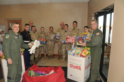 107th Airlift Wing helps out with the Marines Toys for Tots drive. From left to right. Col. John Higgins, Staff Sgt. Erik Sanchez, Lt.Col. William Springer (AF Retired), Maj. David Hutcheson, Cpl. Megan Viccica, Capt. Elizabeth Springer, Capt. Donald Springer, Pvt. Zachary Krebs, Sgt. Maj. Mathew Springer, Sgt. Brandon Springer and Col. Jim McCready. (Air Force photo by Senior Master Sgt. Ray Lloyd)