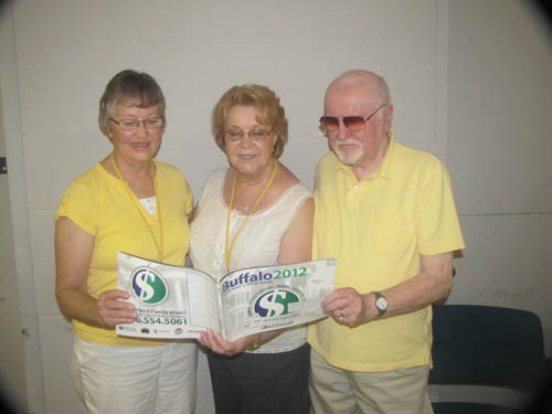 Shown are Carol Kromphardt of Wheatfield, left, and Linda Wingrove examining a `Save Around Buffalo 2011` coupon book with Bill Welch, NT Meals On Wheels president.