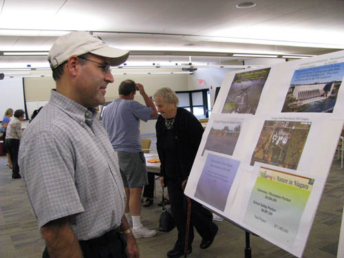 Frank Chiarella of Wheatfield checks one of the information boards detailing Niagara-Wheatfield's planned $11.085 million capital project before voting Tuesday at the high school's Adult Learning Center.