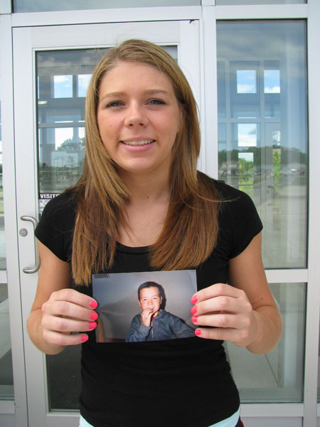 Samantha Stoneham displays a picture of her brother, Shawn. She's organized a fishing derby in his memory to be held at Oppenheim Park on June 19 as a fundraiser for Carly's Club.