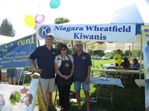 Working at the Wheatfield Family Picnic, from left, are David Karwick, Sara Sperrazza and Danny Maerten.