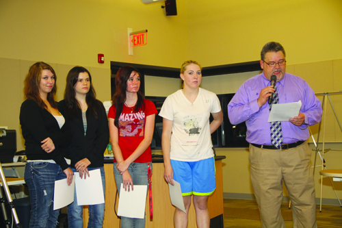 The students who worked on the `A World of 7 Billion` sculpture were honored at last week's Niagara-Wheatfield Board of Education meeting. Shown are Nicole Waldek, Amanda Mrzygut, Gabrielle Cleveley and Elizabeth Suita with N-W High School Principal Timothy Carter. (photo by Janet Schultz)