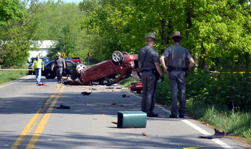 Authorities check the scene of the fatal accident on Walmore Road. (photo by Larry Kensinger/NC News Service)