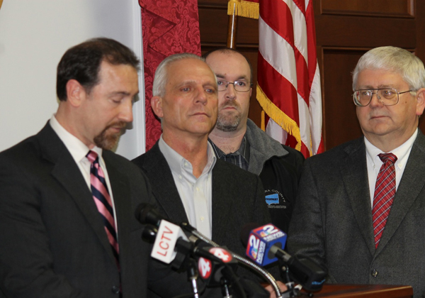 Niagara County Legislator Paul B. Wojtaszek, R-North Tonawanda, addresses local media Tuesday night announcing the formation of the Legislature's ad hoc Committee on Governmental Shared Services and Consolidation as Supervisor Joseph Jastrzemski, R-Wilson, and Supervisor Bob Cliffe, R-Wheatfield, look on.