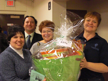 Pictured from left, Lisa Tribunella (program participant at Opportunities Unlimited of Niagara), Gene Colucci (TNBPA president), Candy Promowicz (Beta Sigma Phi Sorority member) and Ona Sherman (Lewiston Service Guild) show off just one of the many theme baskets that will be featured at the 19th annual Baskets O'Plenty Auction on March 8.