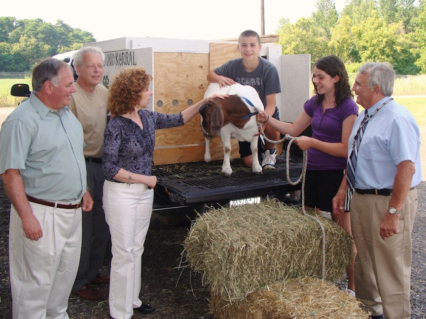 Niagara County lawmakers have long been actively engaged in issues related to agriculture and youth. In this file photo from the Niagara County Fair, Niagara County Legislature Community Services Committee Chairman Tony Nemi, I-Lockport/Pendleton, (left) and Legislature Chairman William L. Ross, C-Wheatfield, (right) visit with local youth bringing a goat to be judged at the fair and officials from Cornell Cooperative Extension of Niagara County. Nemi is among a group of seven county lawmakers opposing new Obama Administration labor rules that would bar anyone under the age of 18 from performing common farm chores.