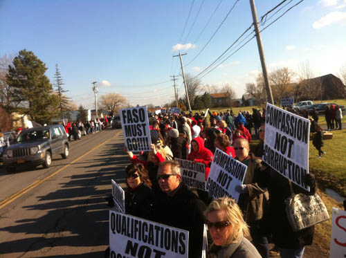 Hundreds of people lined Lockport Road outside the SPCA of Niagara on Saturday to protest what is being alleged as unnecessary euthanizing of animals and mismanagement at the shelter. (photos by Colin Campbell)