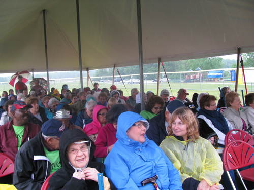 It was damp and chilly, but the seniors were still smiling under the big tent outside.