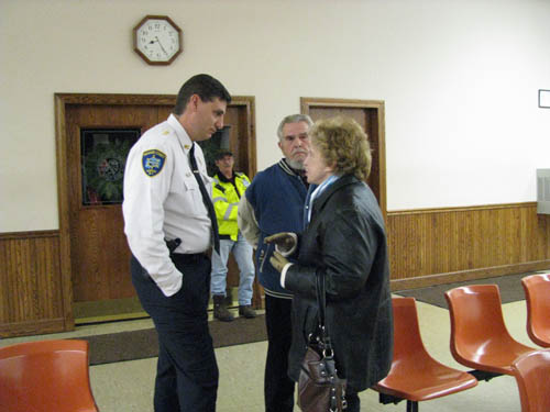 Joan and William Meyers of Town of Niagara talk with Sheriff James R. Voutour at Town Hall.