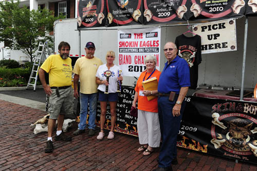 Grand champion for the Smokin Eagles event was Skin and Bones BBQ, the team of Rooster and Lisa Roberts, second and third from left. They are shown with festival organizer Roy `Honcho` Gregory, and Joe and Carlene Phelps.