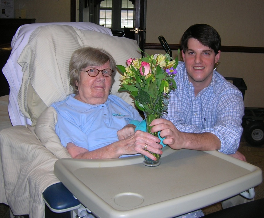 Hospice aide Brandon Jerla brightens the day of Niagara Hospice House resident Catherine Werder with a hearty spring bouquet.