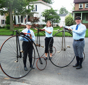 Members of the Buffalo High Wheel Bicycle Club perform at the 2011 Strawberries & Antiques Festival.