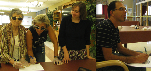 Pictured above, from left, Lorraine Stopa and Alexis Stopa-Weis of Lewiston try a dementia sensitivity exercise with Meghan Fadel, director of education and training with the Alzheimer's Association of Western New York. Another hands-on exercise involved tracing through a maze puzzle with eyes closed relying solely on the directions of a partner, as seen in the second photo.