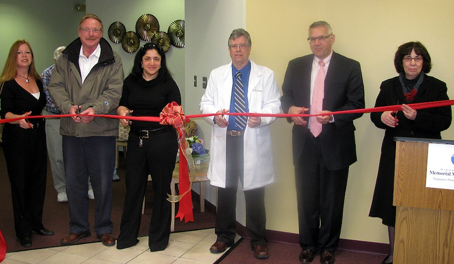 From left, Summit Healthplex Property Manager Cynthia Potts, Project Manager Thomas Hull of D.R. Chamberlain Corp., Dr. Donna Feldman, Dr. Mark D. Perry, Memorial President and CEO Joseph Ruffolo and Vice President and Chief Operating Officer Sheila Kee cut the ribbon to celebrate the completion of a half-million dollars in building renovations and technology and women's services upgrades at the Summit Healthplex.