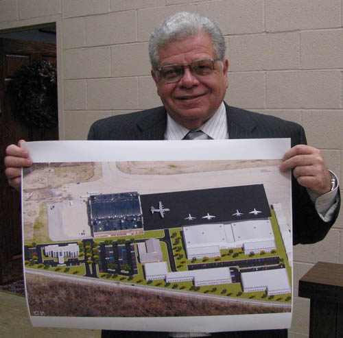 Town of Niagara Supervisor Steve Richards shows a possible plan for use of the surplus former Army property on Porter Road, featuring extra airport parking, airport-related businesses and a four-star hotel. The site for the proposed hotel is at left on the plan.