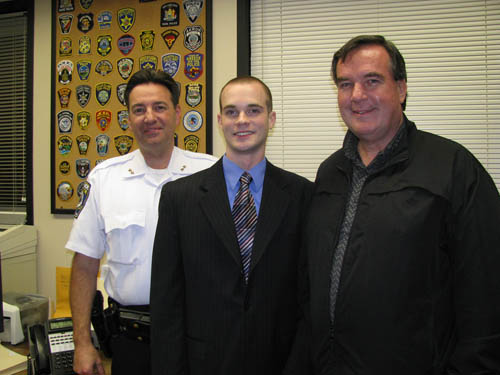 Edward J. Finley, center, was approved Tuesday as the Town of Niagara's newest part-time police officer. He holds an associate's degree in criminal justice from Niagara County Community College and is finishing his bachelor's at Buffalo State College. He is shown with Town of Niagara Police Chief James Suitor, left. Finley remembers doing a ride-along for class credit in the town with his father, Brian Finley, right, who is a former Town of Niagara police officer and a retired state trooper.