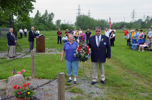 Lioness Jean Pasek and Lion President Boyd Clark place a wreath during the 2011 Memorial Day ceremony in Town of Niagara.