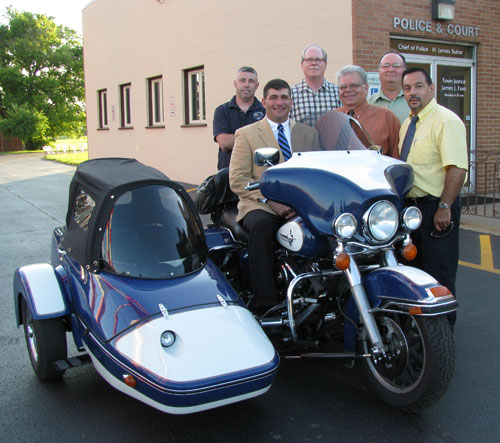Town Board members admire Russell DeFranco's motorcycle after Tuesday's meeting in which they approved his appointment as a part-time Town of Niagara police officer. DeFranco brought his motorcycle for fellow bike enthusiast Supervisor Steve Richards to see and test drive. (photo by Susan Mikula Campbell)