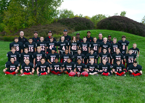 Shown are coaches and members of the Tomcats: top row, Coach Brusino, Coach Gordon, Coach Dolan, Coach Stanley, Coach Parks, Coach Kitchen, Coach Treichler and Coach McDouglad; first row, Ezekiel Capton, Michael Mitten, Brandon Higgins, Roger Adkins, Zach Stanley, Kendra Cheers, Tristian Vandenberg, Griffin Cornwell, Kevin Cannon, Aaron Poe, Jacob Story and Nick Stott; second row, Donovan Brusino, Colton Pankiewicz, Austin Osetkowski, Gabrielle Capton, Warren McDougald, Thomas Peltier, Edward O'Connor, Evan Joseph, Joseph Hahn and Kevin Halford; bottom row, Enrico Liberale, Tyler Camidge, Preston Dolan, Jamel Oliver, Justin McDougald, Jordon Parks, Noah Bennett, Christopher Gordon, Jacob DeWolf and Anthony Davis. Not pictured are: Kevin Bundy Jr., Cody Guiliani, Evan Rohring, Donovan Satterfield, Bryson Solomon, Mario Solomon and Joshua Wisnieski.