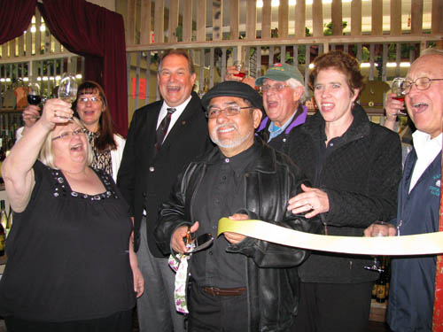 Sanborn business leaders, friends and Assemblyman John Ceretto recently helped Oscar and Melinda Vizcarra (center, first row) celebrate the opening of their latest venture, a satellite wine shop, with a ribbon-cutting and toasts with Vizcarra wines. The shop is located inside the Mill Marketplace, 5890 Ward Road, Sanborn.