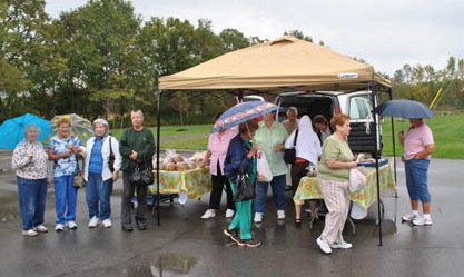 Last fall's Wheatfield Farmers Market opened to rain. Organizers are hoping for a sunnier day when the market reopens next Wednesday, May 25. (photo by Walt Bissett)