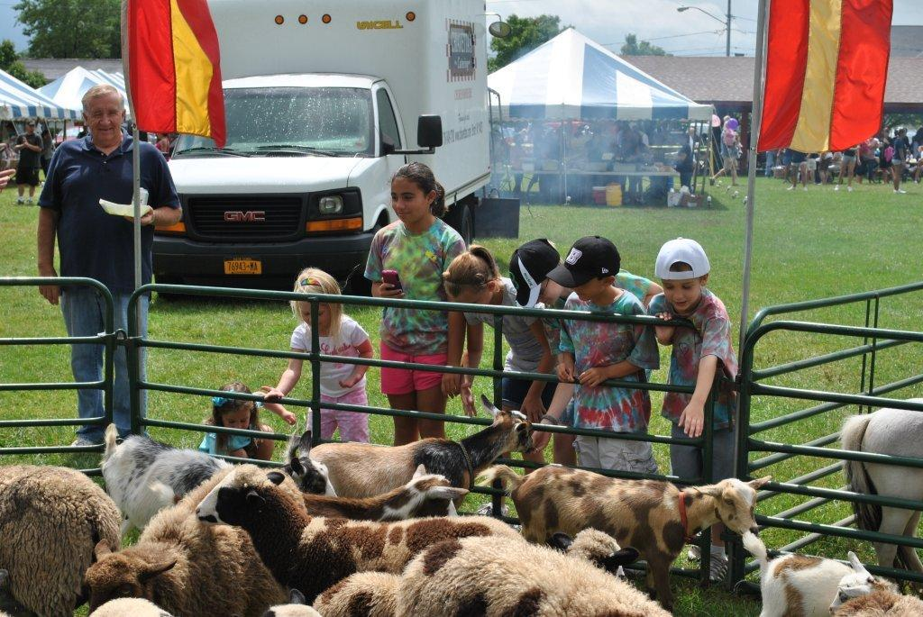 Youngsters enjoy some of the animals at last year's Wheatfield Family Picnic. (photo by Walt Bissett)