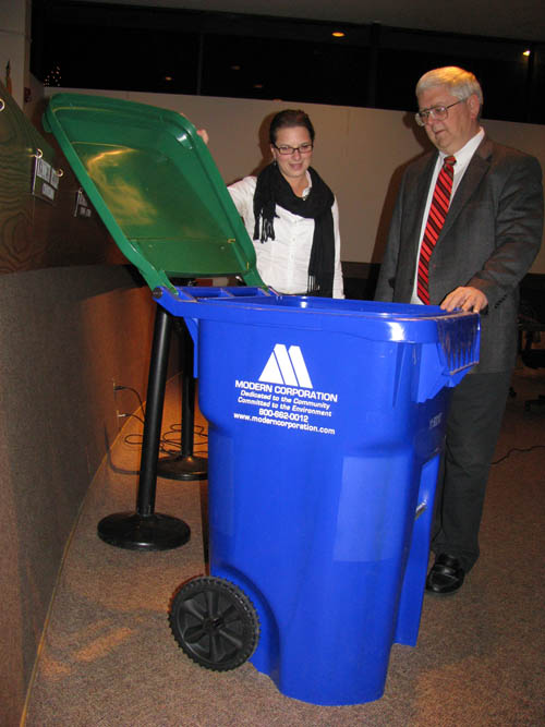Niagara County Environmental Coordinator Dawn Timm and Wheatfield Supervisor Bob Cliffe check out a sample of the new recycling totes to be used by town residents in 2012.