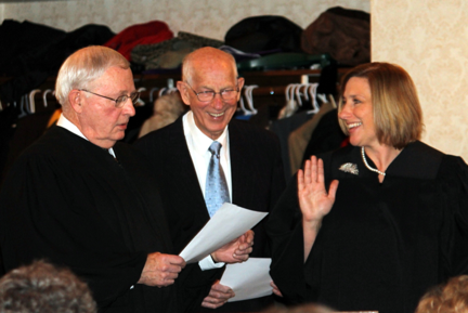 Niagara County Family Court Judge Kathleen Wojtaszek-Gariano, right, recites her oath of office. Administering the oath, at left, is outgoing Family Court Judge David Seaman, while Wojtaszek-Gariano's father, Thomas Wojtaszek, looks on. Wojtaszek-Gariano, the first woman to hold the post of family court judge in Niagara County, has devoted her entire legal career to the practice of family law.