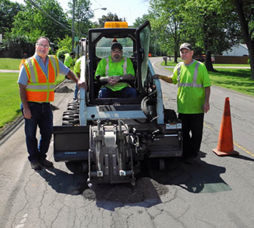 Working on milling the holes on Tuscarora Road are, from left, new Highway Superintendent Robert Herman and town workers Jim Scalzo and John Sullivan. (photo by Marc Carpenter).
