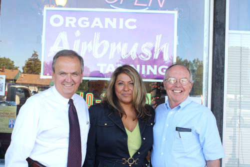 Laura Horey with State Sen. George Maziarz and Cambria Supervisor Wright Ellis in front of her shop.