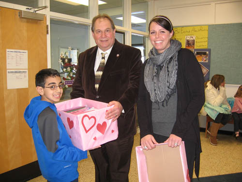 Assemblyman John Ceretto, R,I-Lewiston, recently visited Errick Road Elementary School to thank students for making more than 500 Valentine's Day cards for local seniors. Ceretto's office is working with the school and Meals on Wheels to deliver the cards to seniors this Valentine's Day. Ceretto also will be collecting cards from St. Peter Lutheran School and West Street Elementary School. Shown from left are third grade student Bilal Rizek, Ceretto and Andrea Todoro.